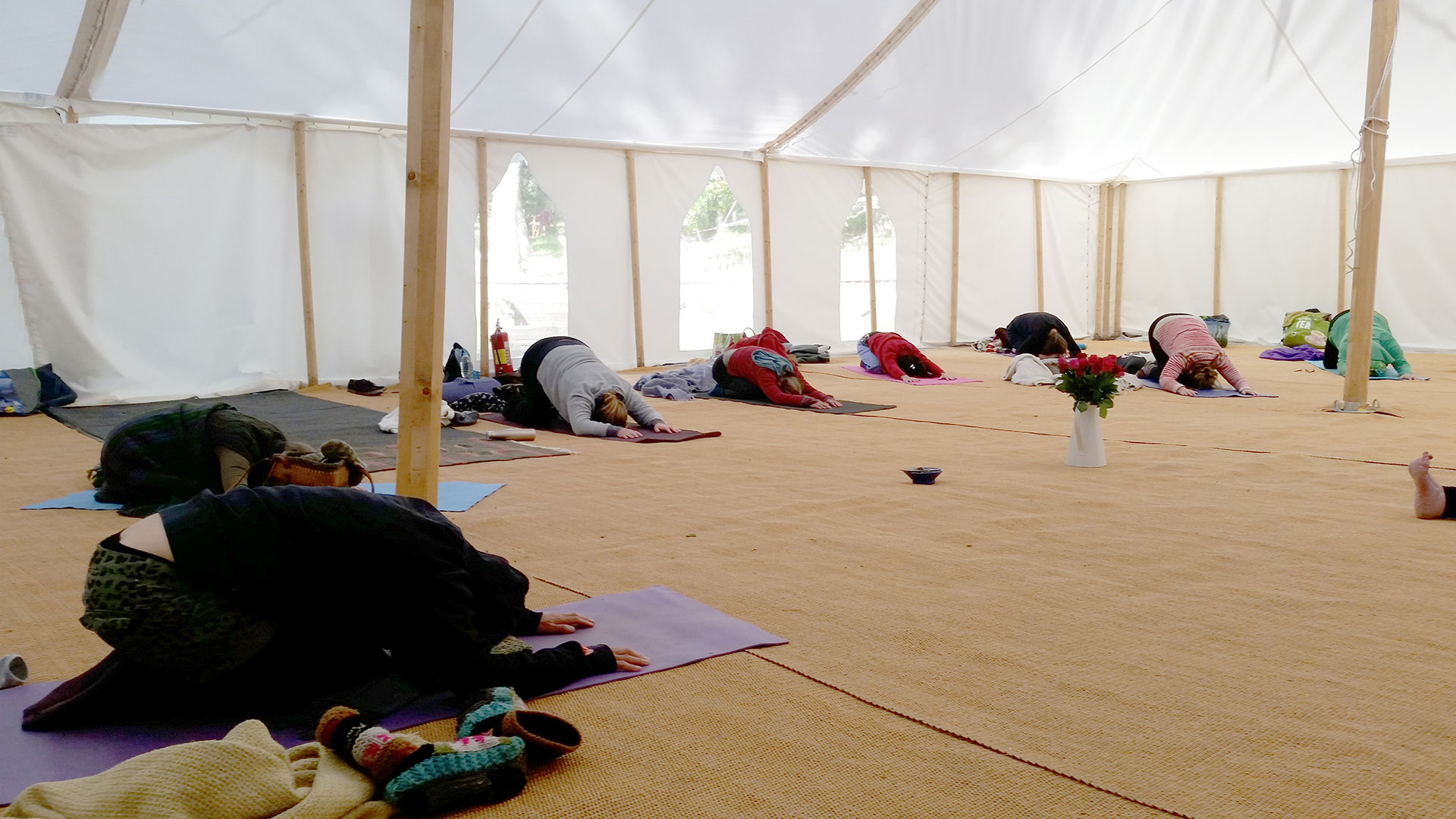 Yoga in the spacious carpeted marquee
